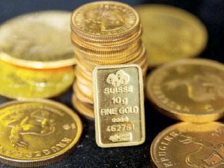 الذهب يرتفع بفعل هبوط الدولار واجتماع المركزي الأوروبي