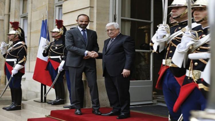 عباس من باريس: نسعى لصفقة سلام تاريخية
