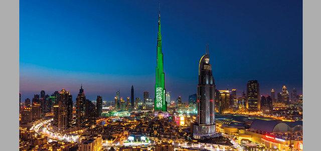«برج خليفة» يتزيّن بألوان العلم السعودي